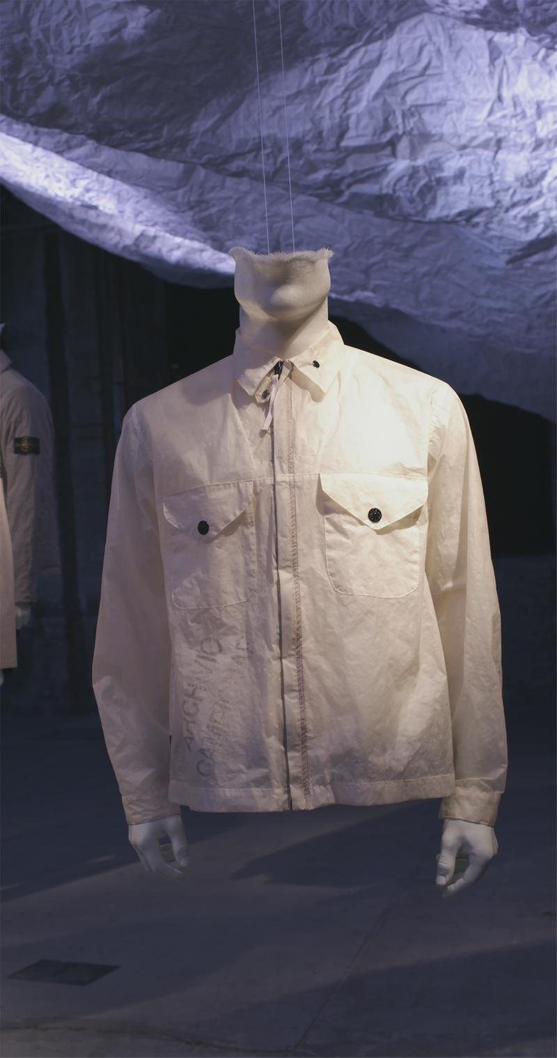 White zip up jacket with shirt collar and two button pockets on the chest displayed on mannequin bust