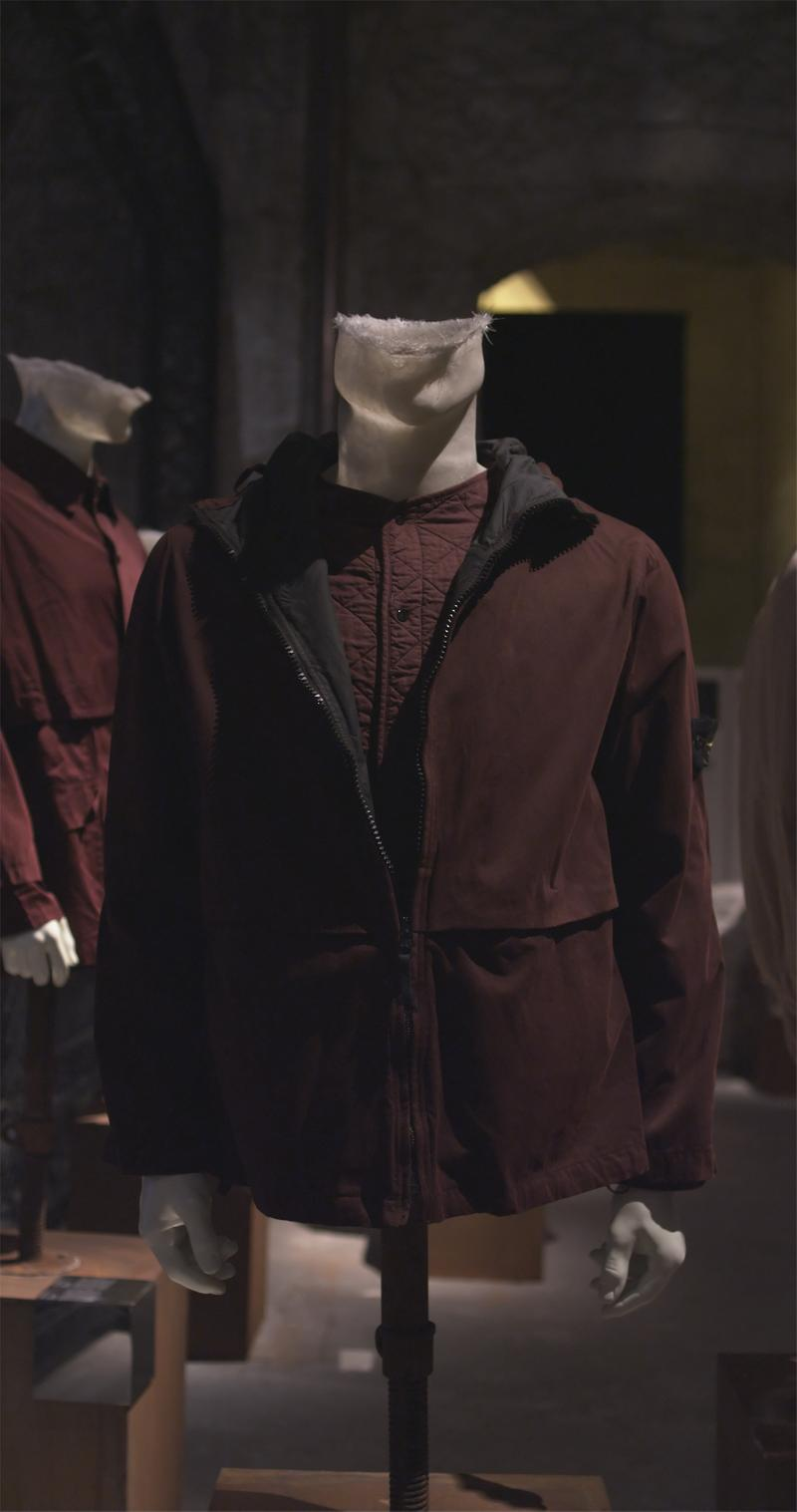 Dark maroon zippered jacket over maroon quilted buttoned shirt displayed on mannequin bust
