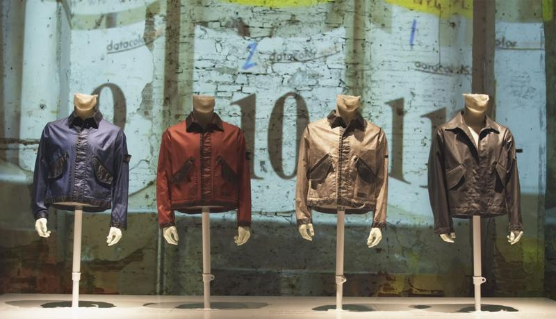 Four jackets in navy blue, red, khaki, and dark brown with collars and flap pockets displayed on mannequin busts