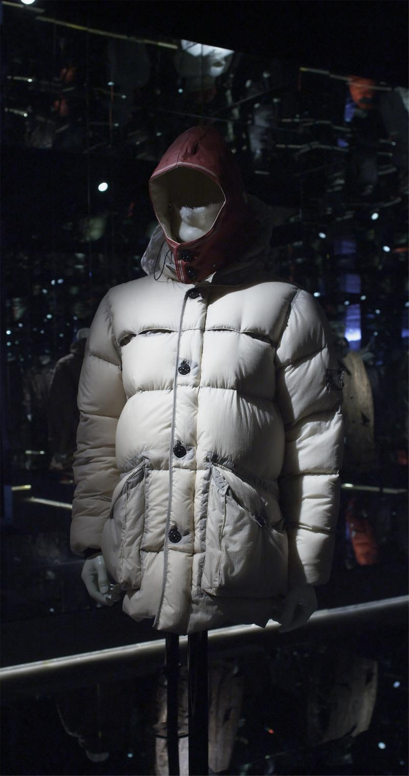 White button up quilted puffer jacket with red hood and front pockets, displayed on a mannequin bust