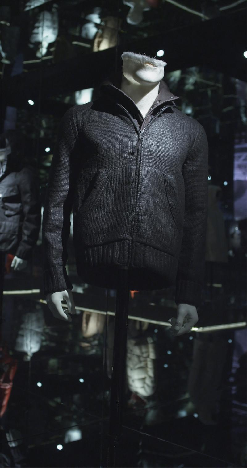 Black zip up sweater with collar, zipper closure side pockets, displayed on mannequin bust