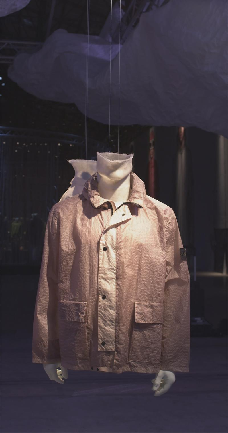 Beige textured jacket with shirt collar, contrasting button placket down the front, flap pockets on the bottom displayed on mannequin bust