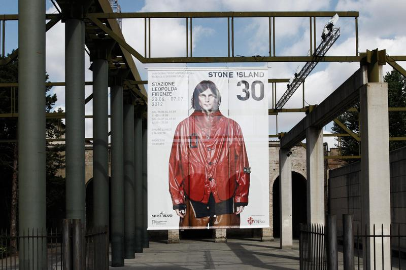 STONE ISLAND 30 photo banner seen from the front with concrete structure behind it