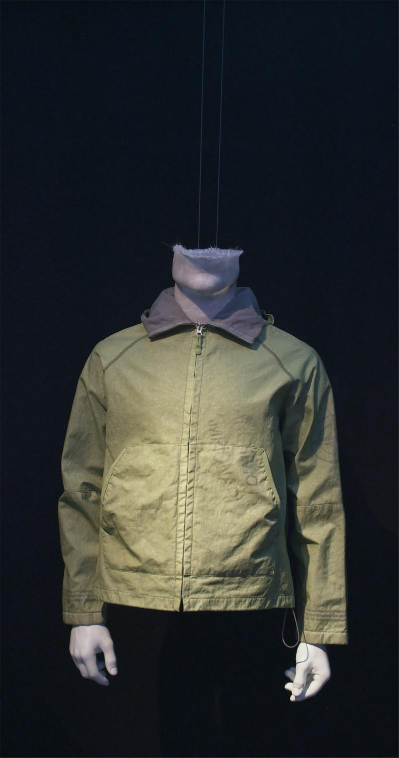 Light green zip up jacket with contrasting shirt collar and side pockets displayed on mannequin bust
