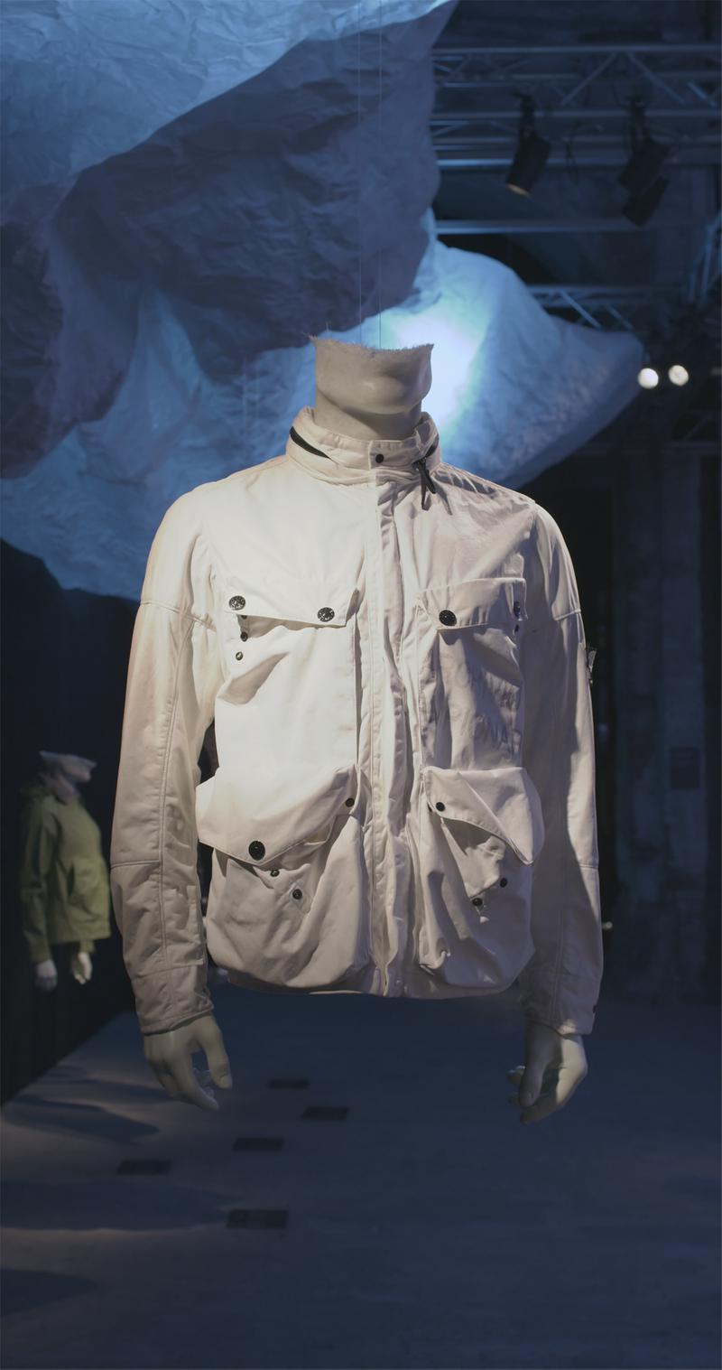 White zip up jacket with stand collar and flap pockets displayed on mannequin bust